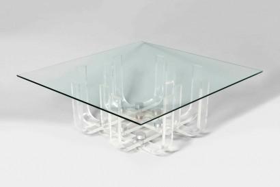Philippe JEAN  (1931 – 1987)     Table basse plexiglas  1972     Plexiglas et fixation chromée  Plateau en verre     Base : H. 34 x L. 65 x P. 65 cm (H. 13.4 x L. 25.6 x P. 25.6 in.)  Dimension totale : H. 35 x L. 95 x P. 90 cm (H. 13.8 x W. 37.4 x D. 35.4 in.)