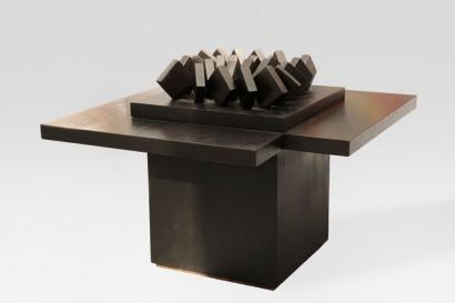 Pol BURY  (1922 – 2005)  Table basse  24 squares Superimposed on 3  1990  Bois et moteur éléctrique  Signé, titré et numéroté sous la base «Pol Bury, 24 carrés sur pointe, n°1/8     H. 53 cm, L. 70 cm, P. 70 cm     Expositions:  - New York, Chelsea Art Museum, «Pol Bury», 11 mars-4 avril 2009  - New-York, Arnold Herstand & Company, «Pol Bury», 1991 (un exemplaire similaire reproduit)  - Dortmund, Musée am Ostwall Dortmund, «Pol Bury rétrospective 1939-1994»,  14 août au 16 octobre 1994 (un exemplaire similaire reproduit)  - Ostende, PMMK – Musée d'Art Moderne d'Ostende, «Pol Bury rétrospective 1939 – 1994», 1er  juillet au 25 septembre 1995 (un exemplaire similaire reproduit)     Bibliographie:  Rosemarie E. Pahke, «Pol Bury», Monographie de l'Art Moderne, avec Catalogue Raisonné (un  exemplaire similaire reproduit n° 90.39, p. 58)