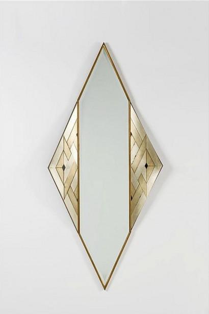 Lorenzo BURCHIELLARO (Né en 1933)     Miroir losange  1988     Motifs géométriques en cuivre argenté et laiton doré  Signé en bas à gauche et daté 1988  H.195 cm, L. 88 cm, P. 12 cm